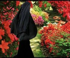 Flower of Islam walking in a flower garden