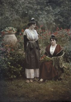 Autochrome: Gervais Courtellemont. An informal portrait of two women wearing the costume of  Arles, Provence, France.