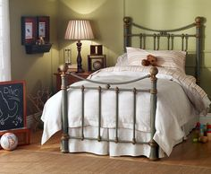"""Wesley Allen Iron Bed """"Quati"""". Choice of 21 antique finishes. XL twin sale price 498.00.  Headboard 53.5"""" high, footboard 36"""" high.  Rising trundle in regular twin only, sale price 278.00."""