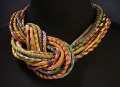 A Susan Sanders Silkworm neckpiece Embellished silk cords.