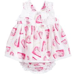 Baby girls, dress and bloomers set byBalloon Chic.The white dress has a lovely pink watermelon print and ruffled shoulder straps ending in bows at the front, with a concealed zip fastener at the back. It is gathered at the bodice, creating a full look and is edged with a layer of white cotton. The matching bloomers have a comfortable elasticatedwaist and legs and have white ruffles across the bottom, perfect for a long summer's day.
