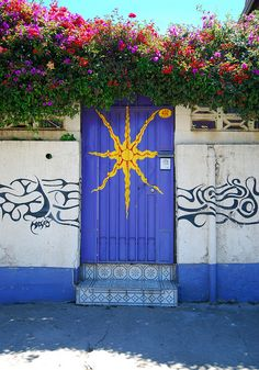 BLUE DOOR WITH A BURST OF SUN IN VALPARAISO, CHILE