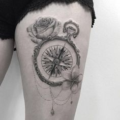 Ornate compass tattoo by Fanny