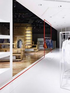 'We are interested in the power of white, which has no individuality,' they say. 'We additionally did not construct any interruptions around the façade and keep the entrance as wide as possible so customers feel no hesitation to enter the shop.'  Once inside, visitors travel deeper into the space that's divided by red lines. The darkest section of the store encourages a more relaxed, slower pace of shopping.