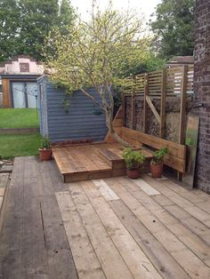 Recycled scaffold boards used as a deck built 2013
