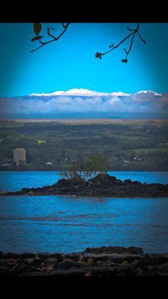 I miss this sight!  Maybe I'll be back soon... Mauna Kea mountain as seen from Hilo Bay, Hilo, Hawaii.