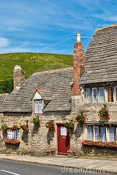 A row of limestone cottages in the village of Corfe Castle, Dorset. || England ◆ United Kingdom