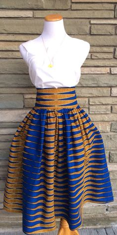 Items similar to African Print Skirt- The Madison Midi Skirt on Etsy African Inspired Fashion, African Print Fashion, Africa Fashion, Fashion Prints, Ethnic Fashion, African Prints, African Fashion Skirts, Ghanaian Fashion, African Attire