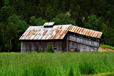 An old barn with a covered bridge somewhere in Norway.