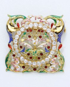 An antique gold, enamel and diamond brooch, circa 1900. Reminiscent of the work of Falize, the square openwork brooch centring a floral motif within a diamond circle, surrounded by acanthus leaves, all decoratd in multicoloured enamel, mounted in gold. 3.2 x 3.2cm. #antique #brooch