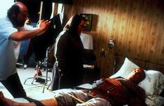 """Rob Reiner directing Kathy Bates and James Caan in a scene from """"Misery"""" 1990"""