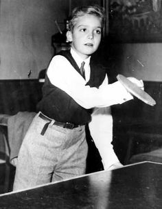 Infante Juan Carlos, eldest son of Infante Juan of Spain, playing a game of ping pong.