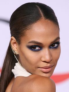 Celebrity Beauty Looks of 2015 - Joan Smalls's navy eye shadow at the Metropolitan Museum of Art's Costume Institute Gala in New York City | allure.com