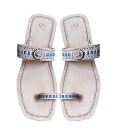 It's not just about staying royal, it's also about style and fashion. All those beautiful ladies who like maintaining their panache might want to pick up a pair of Kolhapuri sandals exclusively designed for them out of pure leather and enhanced with wonderful design. These sandals called as kolhapuri chappal are designed with elegance and they deliver the style and comfort.    Product Description and Care:    High heel, natural color ladies leather sandal with blue lace design on the upper…