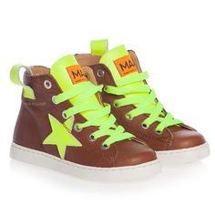 <p>Made in Spain, these unique brown leather trainers by MAA have eye-catching neon yellow trims and lace-up front with a branded badge on the front in contrasting orange. They have a velcro strap and zip fastening with a softly padded inner lining and practical rubber soles that come with a handy fabric storage bag.</p> <ul> <li>Leather upper with rubber soles</li> <li>Velcro and zip fastening</li> </ul>