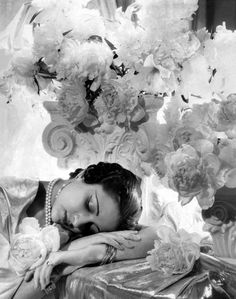 Glamorous excess- blowsy white flowers, pearls and fluid metallic fabrics. Princess Sita Devi by Cecil Beaton ca. 1935
