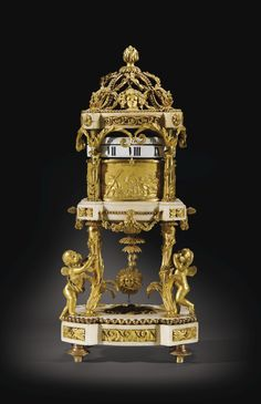 A GILT-BRONZE MOUNTED WHITE MARBLE CERCLES TOURNANTS MANTEL CLOCK, FIRST HALF OF 19TH CENTURY