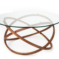 You guys: Orbit Coffee Table from Lookboard is so hot right now. The Orbit coffee table is made up of three interconnected rings of steam bent solid wood supporting a tempered glass top. The modern style of this design is softened by the curvacious form and warm material used.  Available in custom sizes.