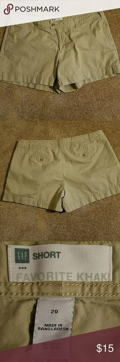 Gap plus size khaki shorts Waist measures approximately 42 inches. Inseam measures approximately 4 inches  . Front and back pockets.  Zipper and button closure.  Good used condition GAP Shorts