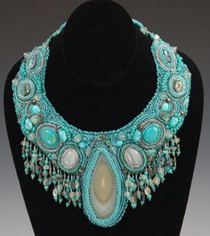 SuzYum Designs.... intricate, ancient, amazing!