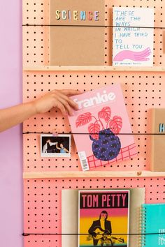 Make sure your books have the *cutest* home with this DIY ombre book shelf tutorial.