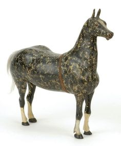 """American mid 19th century, beautifully carved and detailed figure of a horse, stipple painted polychromed surface, natural hair tail Size: 12"""" t. Condition: excellent $9000, 09-30-2006, Noel Barrett Vintage Toys & Auction."""