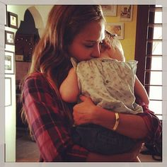 Jessica Alba cuddling with her daughter, Haven.