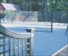 Verde Lattice Tennis Court - Walpole serves up sophisticated choices around the court that include this curving rail Lattice with sandwiched chain link fence.