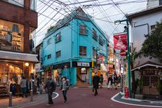 Shimokitazawa: Tokyo's Greenwich Village. Cyan-coloured building at an intersection of Shimokitazawa.