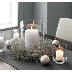 Petite wreath sparkles a plenty, shimmering silver on the door or embracing a pillar candle. Beautifully surrounds a 3 inch pillar candle.