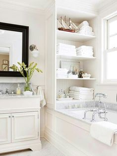 For those who only have a bath tub, this is a great way to not only have storage for your bath towels but as well be a nice presentation for guests.