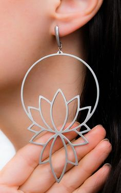 Statement lotus flower earrings made of stainless steel. These hoop earrings have a unique floral design that makes them not-so-ordinary but at the same time they are still hoops.
