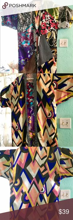 Robe/kimono Sacred Threads M/L one size One of a kind, multicolor, reversible lounging robe by Sacred Threads. Label has been removed so I'm not certain of the material. It's heavier than silk or rayon; feels like satin. Each side is unique - one multicolor, patchwork of florals and abstract designs, the other an Art Deco geometric pattern. The floral side has small belt loops just under the arms, no loops on the other side. I've misplaced the belt, but I usually cinched it with a silk neck…