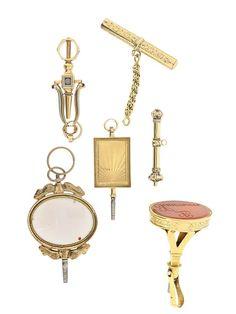 6 GOLD-UHRENSCHLÜSSEL, darunter grosser Schlüssel als Siegel mit Karneol, der Namenszug in Spiegel