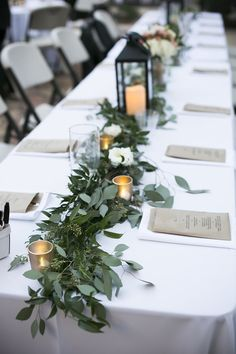 Long wedding tablescape used greenery + candles + lantern #weddingtabledecor #weddingtablescape #longtable #weddingreception