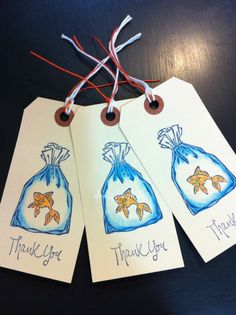 Three sparkly gold fish tags on Etsy, $3.00