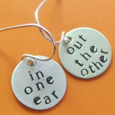 "Custom Stamped Text Earrings.  Shown with ""in one ear, out the other"""