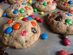 """How do you make a super soft, thick and chewy cookie filled with M&M's, Heath Toffee Bits, peanut butter, and oats even better? Stuff a Reese's Peanut Butter Cup inside! If you've never heard of Monster Cookies before, my question to you would be, """"Who are you??"""" To bring you up to speed, the Monster … Best Peanut Butter Cookies, Creamy Peanut Butter, Peanut Butter Cups, Toffee Bits, Chocolate Toffee, Perfect Cookie, Desserts, Buffets, Sweet Stuff"""