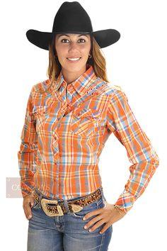 Camisa Feminina Cowgirl Up Manga Longa Bordada Xadrez   Camisa Feminina Cowgirl Up, importada. Manga longa, tecido 100% algodão, xadrez, prevalecendo a cor laranja. Dois bolsos, fechamento em botão tradicional. As camisas Cowgirl Up tem corte acinturado que molda ao corpo, e pode ser usada no dia a dia, em competições, rodeios ou eventos informais. Para cowgirl que gosta de estar sempre bem vestidas e na legítima moda western.