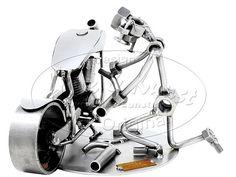 Schraubenmännchen Motorradmechaniker . Schraubenmännchen Motorradmechaniker Hier schraubt der Mechaniker an einem Motorrad. Nutzen Sie dieses oder ein anderes