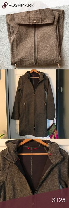 """Lululemon rain trench coat size 4 For sale is a great Lululemon rain coat size 4. It is in excellent condition, having only been worn a couple times. Features hood w/ drawstrings for a snug fit, two front zippered pockets, waist drawstring, fleece lining, double zipper, and place to attach headphones on the inside of the jacket. Color is a grayish-brown and white speckle. Measurements: 36.5"""" long from shoulder, bust: 17"""" laying flat from underarm to underarm. Sleeve length from shoulder is…"""