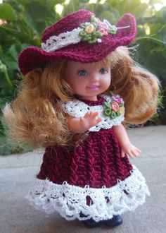 Burgundy and white crocheted dress in size 10 thread with embroidery added to hat and collar. Dress crocheted by Shirley ☆ Crochet Barbie Clothes, Girl Doll Clothes, Doll Clothes Patterns, Doll Patterns, Crochet Barbie Patterns, Easy Crochet Patterns, Crochet Dolls, Chelsea Doll, How To Make Clothes