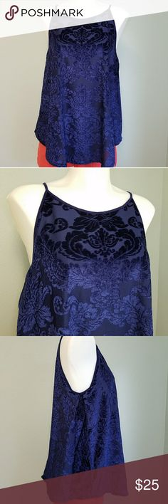 """Cable & Gauge Velvet High Neck Tank Top Floral velvet tank top with spaghetti straps in a high neck style. Keyhold back with single button detail. Handkerchief style hem. Sides have a pleat style opening for the perfect flowy fit. Excellent condition. Navy blue. 100% polyester. Lining is the softest 100% viscose. Size Large. 18"""" bust. 23"""" across lining hem. 23"""" front long. 24"""" back. Cable & Gauge Tops Tank Tops"""