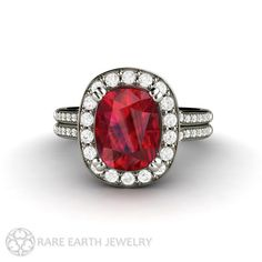 A gorgeous large Ruby ring with a diamond halo. At the center is a 2.75ct cushion cut Ruby. Its surrounded by a halo of conflict free diamonds, and