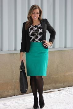 Teal/turquoise pencil skirt with black and white patterned top with black hose/pumps and blazer...