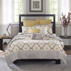 The perfect geometric ikat design for your casual space. The Ink+Ivy Ankara Coverlet Mini Set features soft shades of yellow and grey in this modern design.