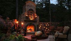 barbecue extérieur avec un coin de détente très confortable