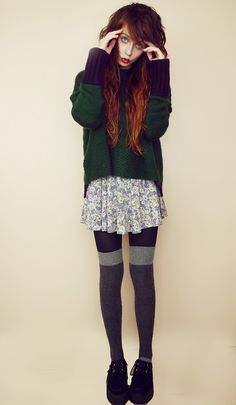 bagyy sweater on top of flowery dress