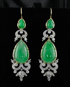 Natural green jade and diamond earrings, circa 1950's