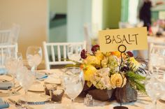 "The ""Basalt"" table from a geologist's wedding at Grounds for Sculpture, New Jersey. Each table built the flowers into a different rock foundation."
